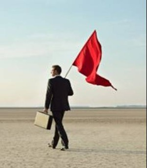 red flags with men going